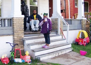 Toys in this photo, showing Charles Jones on front porch and Aiyana's classmate Diamond, 7, are the same toys seen in the evidence technician's photos of the house. Defense has contended it was too dark to see them, but there is a bright atreetlight just one door down, which was working according to other photos.