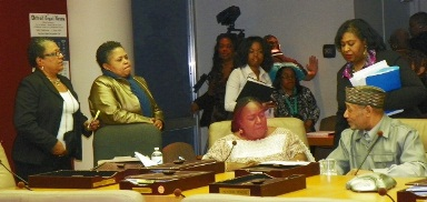 Council Member JoAnn Watson (center) with her staff members (l) Debra Taylor and Monica Patrick, consults with Council Members Brenda Jones and Kwame Kenyatta after the Council's 5-4 vote for the sell-out Consent Agreement April 4, 2012.