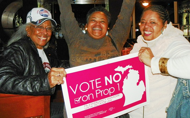Chris Griffith, Monica Lewis-Patrick and Sandra Hines celebrate the defeat of Public Act 4 at the polls Nov. 6, 2012.