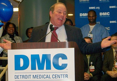 Mayoral candidate Mike Duggan earlier celebrating his turnover of the DMC to the for-profit Vanguard Health System, 70 percent owned by a Wall Street hedge fund. Duggan bailed out as CEO of the remaining governance agency recently, before hundreds of lay-offs of DMC workers were announced. He also recently left the board of Gov. Rick Snyder's Educational Achievement (Apartheid) Authority.