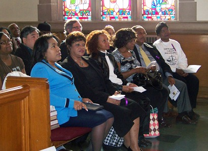 Some of Maryanne Godboldo's family members at Hartford Memorial Church rally shortly after her release from jail in 2011. Her sister Penny is third from left.