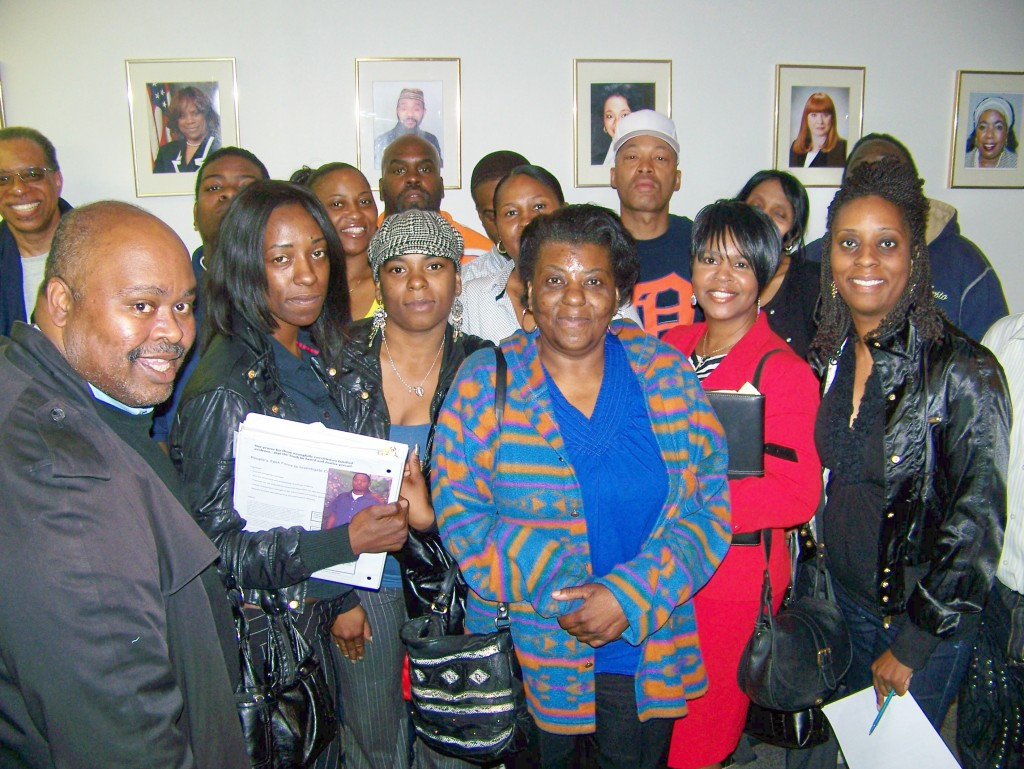 Kevin Carey (l), organizer of People's Task Force, with family members of prisoners wrongly incarcerated due to crime lab errors, after City Council hearing May 11, 2009.