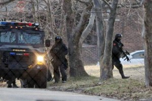 Police with assault weapons prepare to storm Godboldo home March 24, 2011.