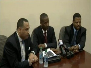 Family spokesman Skip Mongo (l) with attorneys for teen in lawsuit vs. Pugh,