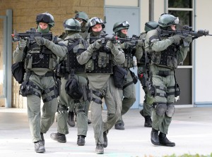 """Members of the San Diego County Sheriff's Department Special Enforcement Detail move onto Poway's Abraxas High School's grounds in a """"Lockdown and Active Shooter Response"""" simulation on Wednesday."""