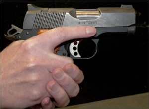 Firearm safety involves keeping finger off trigger, even when someone grabs weapon.