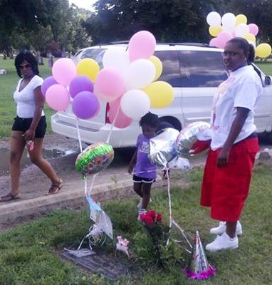 Aiyana's family members at her graveside on her birthday July 20, 2013.