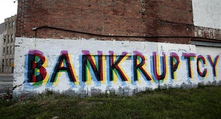 "Someone painted ""Bankruptcy"" on wall of building on Grand River near I-75. The letters are in black, green and red, colors of the Black nation."