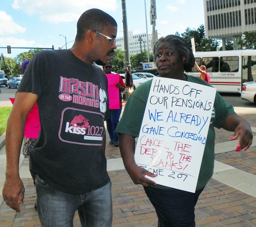 AFSCME Local 207 officer Laketa Thomas talks with another protester outside the CAYMC July 25, 2013.
