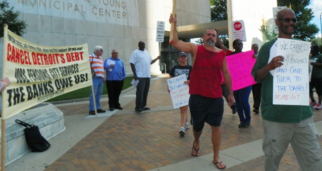 Retirees, union members and their supporters protested outside the Coleman A. Young Center July 25, 2013.