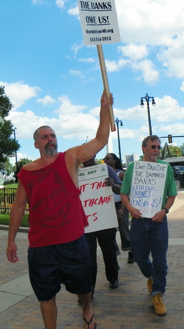 DWSD workers including Local 207 VP Mike Mulholland at right during July 25 protest.