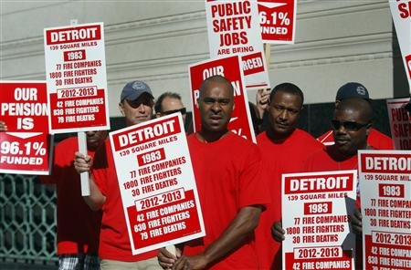 Detroit firefighters protest bankruptcy filing outside court July 24, 2013.