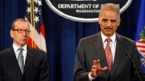 Attorney General Eric H. Holder Jr., right, and Lanny A. Breuer, the head of the Justice Department's criminal division, announce criminal charges against two UBS traders.