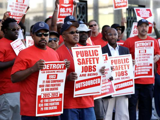 Detroit firefighters protest outside courthouse July 24. Photo: Paul Sancya, AP