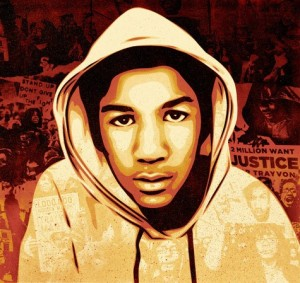 "Detroit T-shirts use this image, only in red and white on black, and declare ""Justice for Trayvon Martin."""