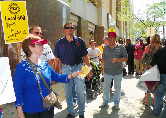 Protesters demand the banks pay for Detroit's crisis, outside BOA offices in the Guardian Building Aug 19, 2013.