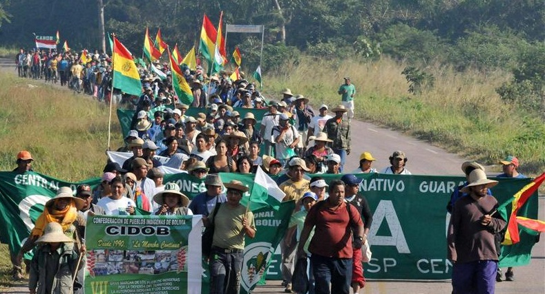 Bolivia's indigneous people march to stop construction of highway through their ancestral lands.
