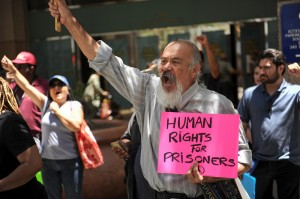 Guillermo Cuauhtemoc protests outside the Ronald Reagan State Building in downtown L.A. Monday, July 8, 2013, against solitary confinement in California prisons. (Michael Owen Baker/L.A. Daily News)
