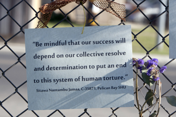 Hunger striker supporters displayed photos and quotations from several of the movement leaders, including Sitawa, at the July 13 rally outside Corcoran State Prison. – Photo: Malaika Kambon