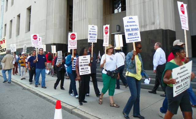 Detroit retirees and supporters protest outside bankruptcy court hearing Aug. 2, 2013.