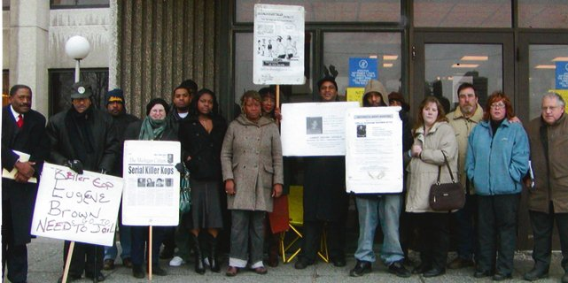 Members of Detroit Coalition Against Police Brutality including families of Lamar Grable and Derrick Miller. Herman Vallery is second from left, Lamar's sister Arnetta Jr. and mother Arnetta Grable are right of Serial Killer Kop sign.