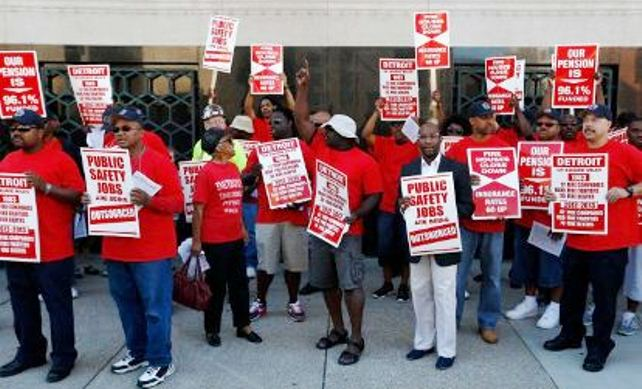 Orr threatened Detroit firefighters over their actuary's claim that their system is 96.1 percent funded. Here they protest outside first bankruptcy hearing July 24, 2013.