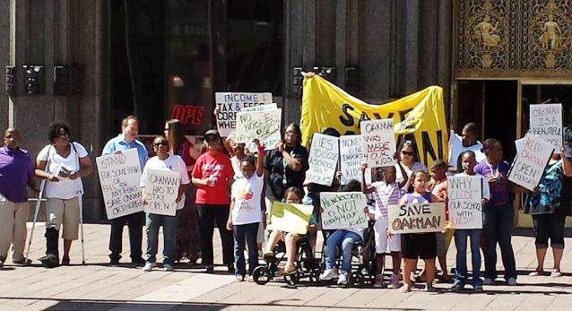 Protest against closing of Oakman Orthopedic School in Detroit July 24, 2013.