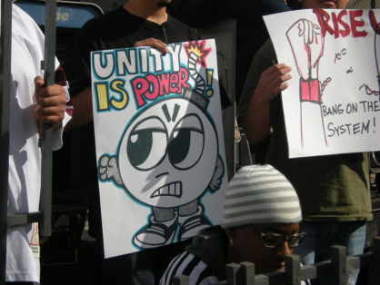 """A rally organized by LA's Youth Justice Coalition ushered in a new era for California prisoners – the End to Hostilities – on the day it took effect, Oct. 10, 2012. A prisoner at Corcoran said recently, """"The End to Hostilities has opened up a whole new world to us."""" Spreading the spirit of solidarity to the streets is critical now that the California prison system has expanded eligibility for indefinite placement in solitary confinement from prison gangs only to street gangs. – Photo: Virginia Gutierrez"""