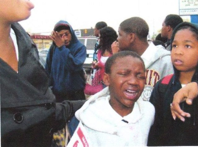 Students after police pepper spray atack during 2007 protest against school closings outside Northern High School.