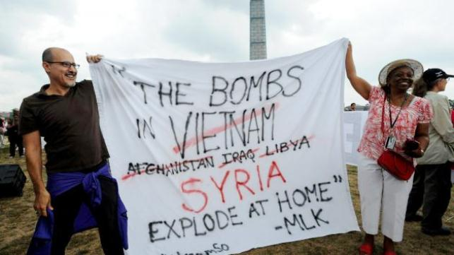 Protesters condemn U.S. War on Syria during Pres. Barack Obama's speech Aug. 28, 2013.