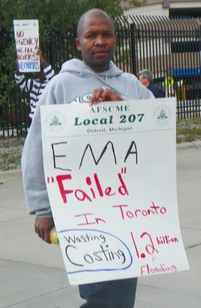 WWTP worker on strike Sept. 30, 2013 denounces EMA plan to cut DWSD workforce.