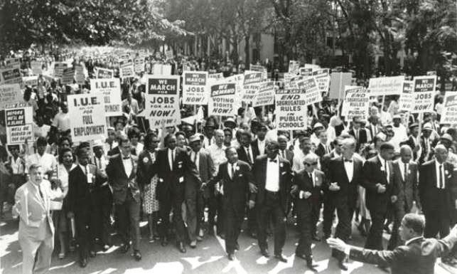Dr. Martin Luther King, Jr. (center left) leads 1963 March on Washington for Jobs and Freedom.