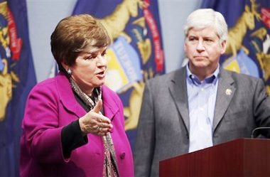 Mich. Dept. Human Services head Maura Corrigan and Gov. Rick Snyder