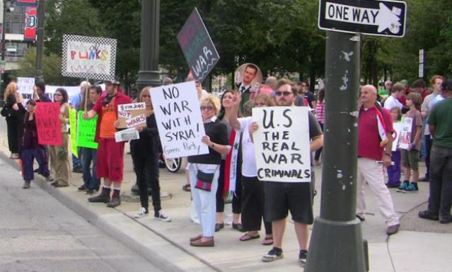 Protesters lined Woodward Avenue in Detroit Sept. 8 to stop war on Syria.
