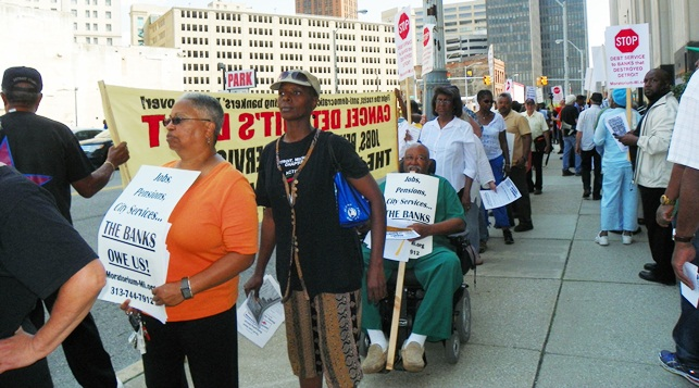 Retirees and residents protest at bankruptcy court hearing Aug. 19, 2013.