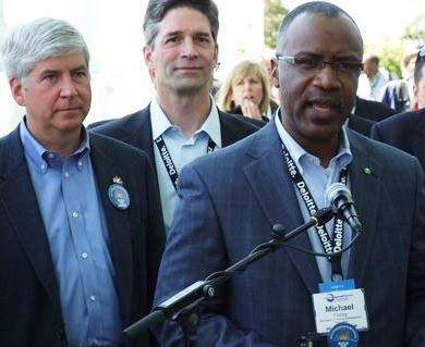 Gov. Rick Snyder, DTE CEO Gerry Anderson, and MEDC head Michael Finney.