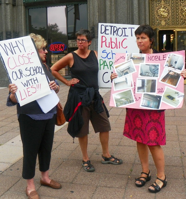 State School Board member Marianne Yared McGuire (l) with others at rally to stop school closings Aug. 28, 2013.
