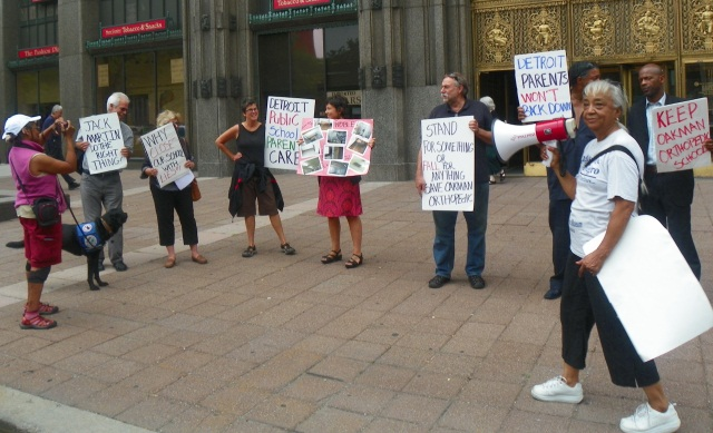 Helen Moore rallies protesters.