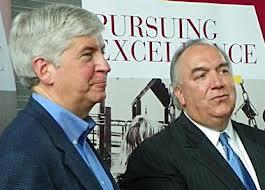 Michigan Gov. Rick Snyder and former Gov. John Engler
