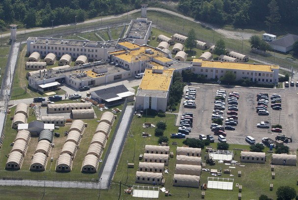 Temporary structures are constructed around a building at Angola State Penitentiary in West Feliciana Parish, La., Monday, May 9, 2011. A convoy of buses and vans transferred inmates with medical problems from Angola, which is bordered on three sides by the Mississippi River, while other inmates were moved to buildings on higher ground as part of an effort to prepare for possible flooding. (AP Photo/Patrick Semansky) Read more: http://www.kitsapsun.com/photos/2011/may/09/197608/#ixzz2gaDNAxZu  Follow us: @KitsapSun on Twitter | KitsapNews on Facebook