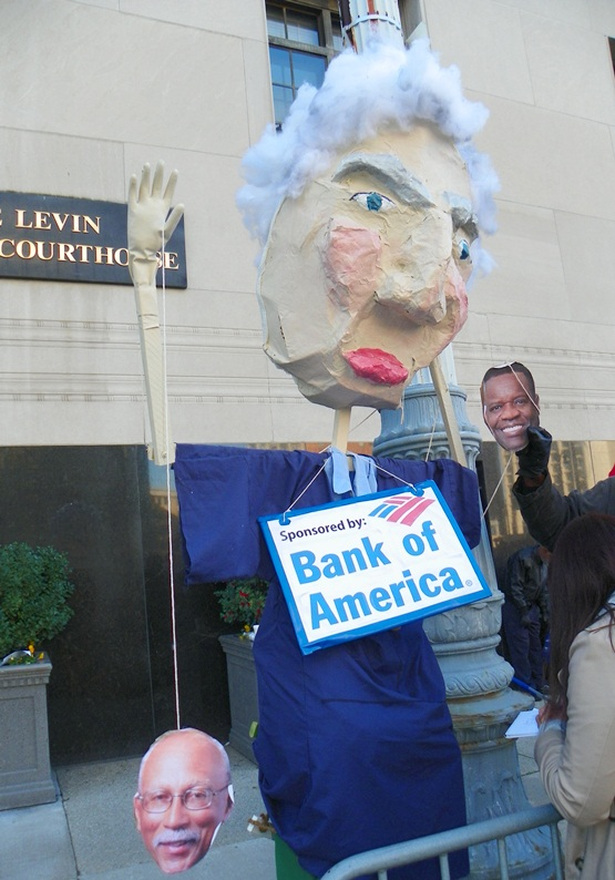 Protesters decried banks' role in Detroit takeover.