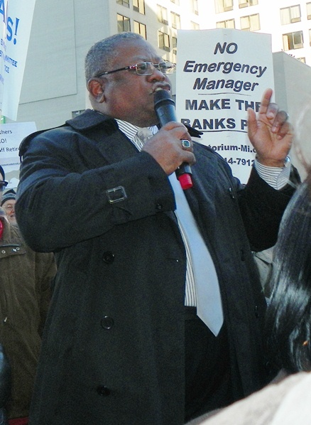 Ed McNeil of AFSCME Council 25 speaks at rally.