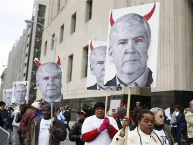 Protesters outside federal court in downtown Detroit during Mich. Gov. Rick Snyder's testimony at Detroit bankruptcy trial.
