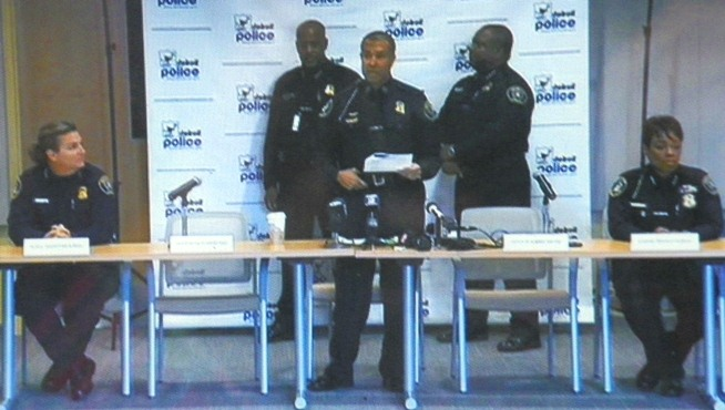 Deputy Chief Vicki Yost (l) with Police Chief Craig (center) and Asst. Chiefs at press conference Oct. 8, 2013.