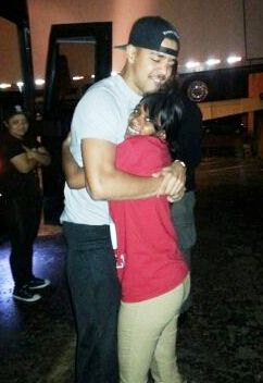 J. Cole shows his love and support for Dominika Jones, Aiyana's mother, during Detroit concert Oct. 10, 2013.
