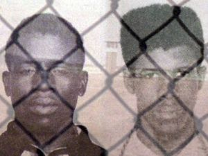 Black Panthers Herman Wallace and Albert Woodfox with Angola prison in background.