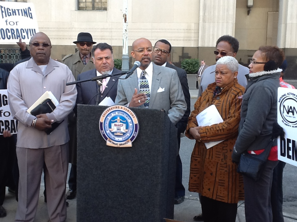 Attorneys Nabih Ayad and Melvin Hollowell (at podium) with plaintiffs announce lawsuit against PA 436 May 13, 2013.