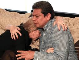 Father, Israel Hernandez Romera and sister, Offir Hernandez, of Israel Hernandez-Llach console each other after his death.