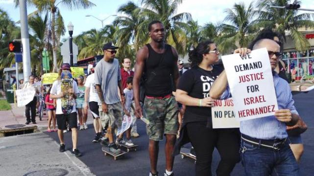 On Oct. 8, protesters demand cop arrest in taser death of graffiti artist Israel Hernandez  in Miami Beach, Fla./Reuters photo