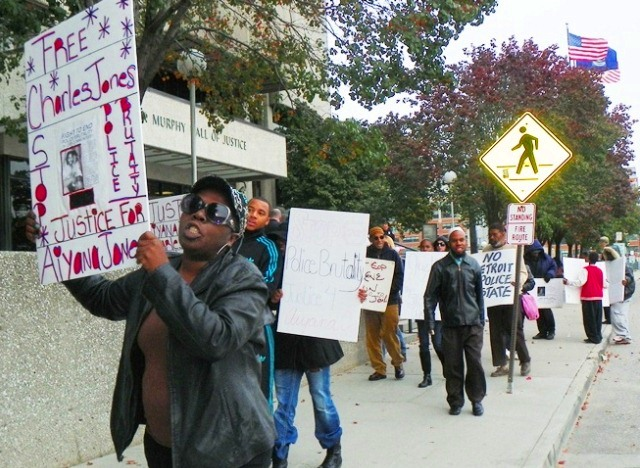 Aiyana Jones' grandmother Mertilla Jones marches Oct. 21, 2013 with familes of Davontae Sanford, Lamar Grable, Cornell Squires, and other victims of Detroit police killings and brutality.